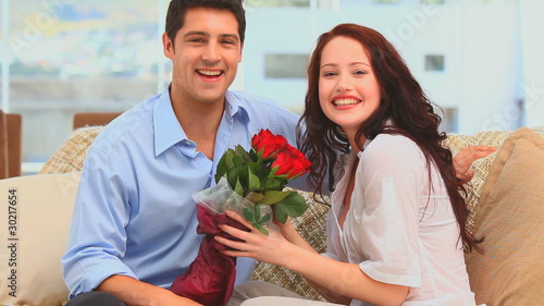 Man giving a bunch of flowers to his wife