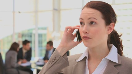 Business woman speaking on the phone