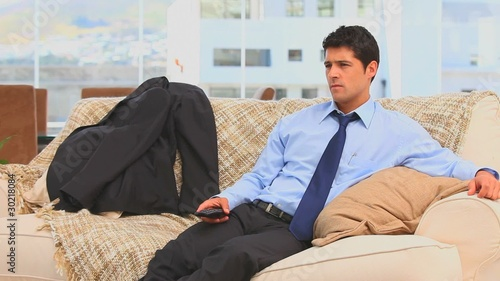 Tired businessman after work sitting on his sofa