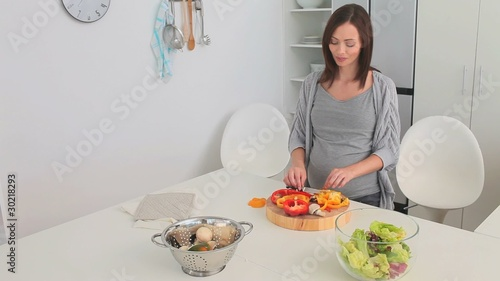 Pregnant female cooking