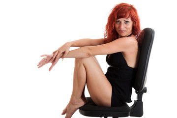 Full-length portrait of sexy young red-haired woman