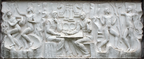 Concrete relief representing a chess game and sport activities