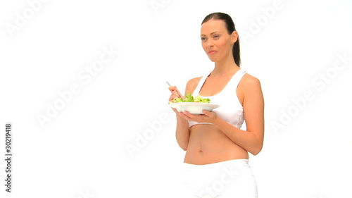 Woman in sportswaer eating a salad