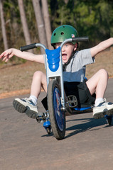 child having fun on trike