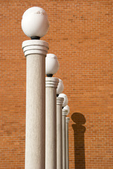 lamps on five white columns and red wall