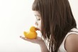 little toddler girl kissing a yellow bath duck