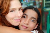multiracial mother and daughter family hug poster