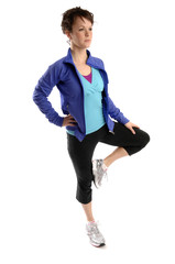Young sporty woman exercises