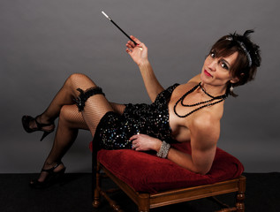 Beautiful young adult woman portraying a 1920's style flapper.