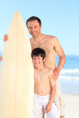 Father and son with their surfboards