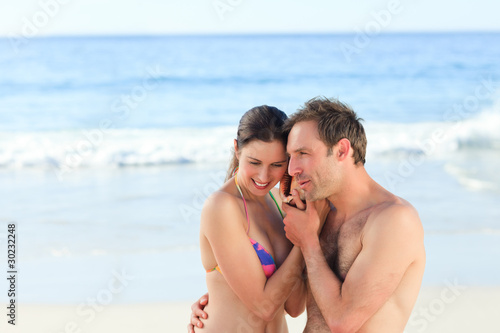 Couple listening to their shell