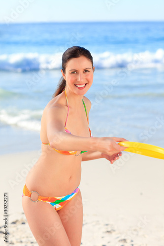 Beautiful woman playing frisbee