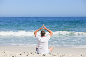 Man doing his stretches on the beach
