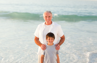 Grandfather and his grandson at the beach
