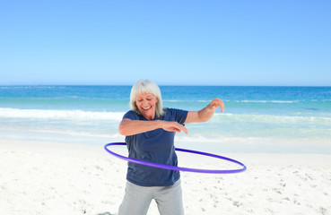 Senior woman playing with her hoop