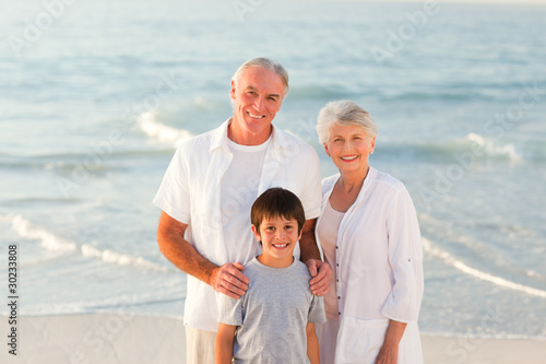 Grandparents with his grandson at the beach