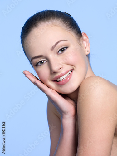Smiling woman with healthy skin of face