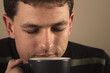 Portrait of man drinking hot beverage