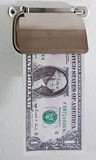 Dollar bill poking out of a toilet roll holder poster