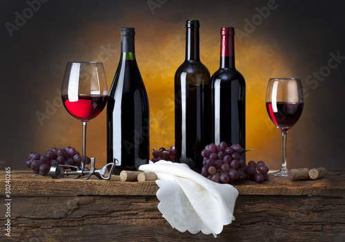 still life with red wine and drapery