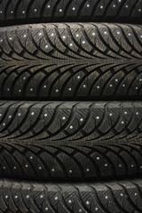 car tyre on black studio background