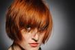 Beautiful red heaired woman portrait with creative trendy make-u