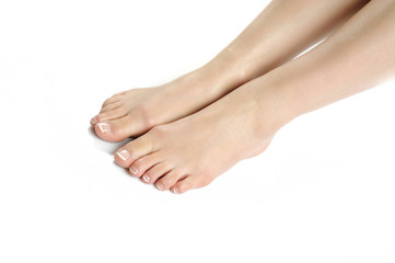 Beautiful feet leg with perfect french spa pedicure. white backg