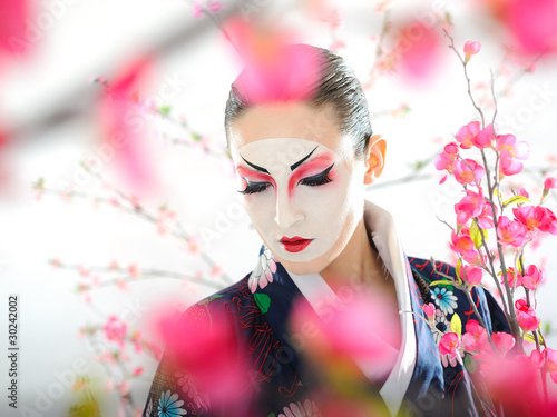 Artistic portrait of japan geisha woman with creative make-up ne