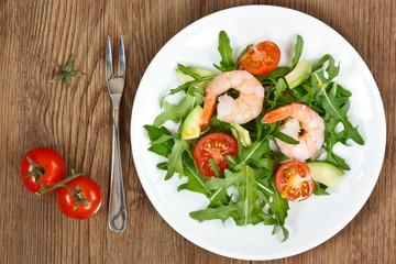 Arugula salad with prawn.