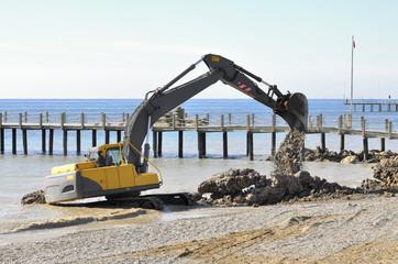 Bulldozer Rebuilds Rocky Beach before season