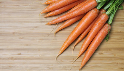 fresh carrots on wood