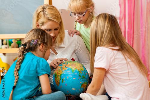 Mother explaining the world to her children