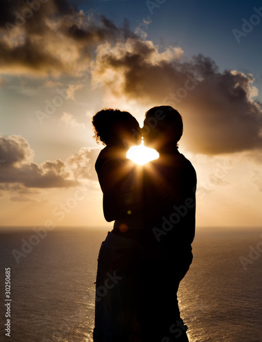 Silhouette of a young couple at sunset