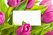 A bunch of pink tulips with business card.