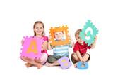 Kids having fun learning alphabet ABC