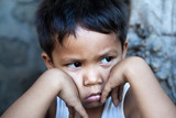 Young Filipino boy portrait - poverty in the Philippines poster