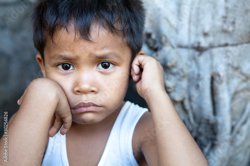 Asian boy against wall portrait