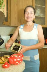 elderly woman making tea