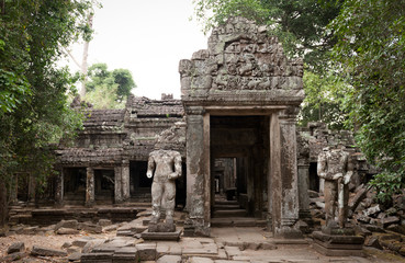 Headless statues gurad the ruined temple of Preah Khan