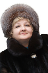 Beautiful woman wearing in fur hat and in fur coat