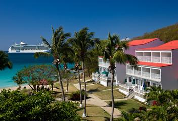 Cruise ship sails by vacation resort