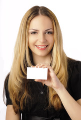 Pretty girl holding a blank card