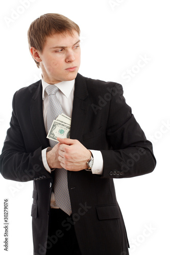Man in a putting money in his pocket.