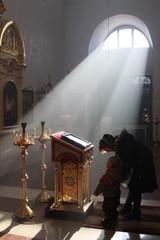Prays in an Orthodox church.