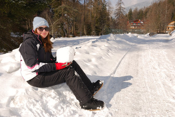 Girl with a big snowball