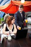Young business woman and her partner on lunch poster