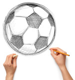soccer football ball and hand with pencil