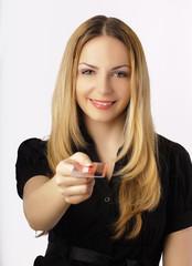 Beautiful woman holding credit card