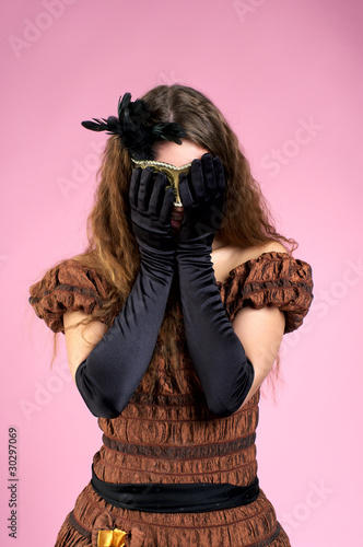 Beautiful woman hiding her face by hands