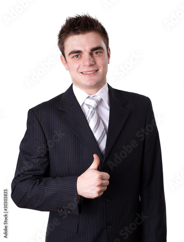 Portrait of a happy young business man showing thumbs up sign